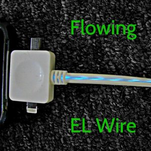 Blue Flowing EL Wire on White or Black Cord